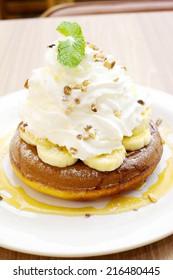 Pancake with caramel sauce And bananas, whipped cream