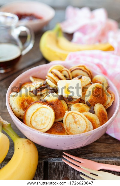 Pancake cereal, mini pancakes in a bowl with maple sirup