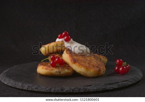 pancake, fritter, syrniki on slate texture