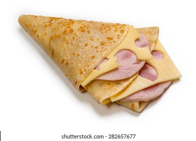 Pancake with ham and cheese isolated on white background