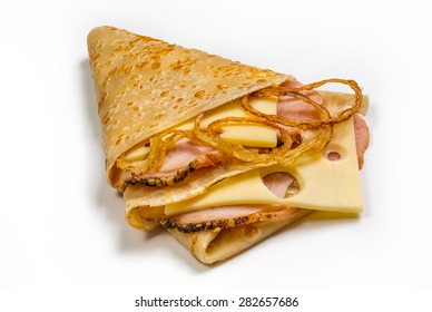 Pancake with ham, fried onion and cheese isolated on white background