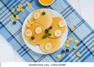 Pancake Plate Blueberry Honey Dessert Flat Lay. Fried Golden Sweet Crepes for Tasty Shrovetide Breakfast. Hotcake Syrop Product on Blue Tablecloth with Berry and Banana Top Down. Homemade Morning Food