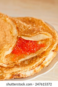 Pancake with red caviar. Traditional Russian cuisine