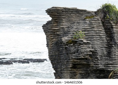 Pancake rocks and blowholes, Punakaiki New zealand.   The Pancake Rocks at Dolomite Point near Punakaiki are a heavily eroded limestone area where the sea bursts through several vertical blowholes.