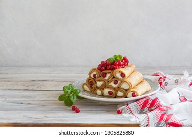 Pancake rolls with ricotta and mascarpone with red currants.