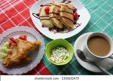 pancake, sambosa, marsmellow and hot coffee milk is best disk for breakfast