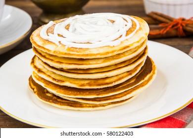 Pancake with sour cream. Studio Photo