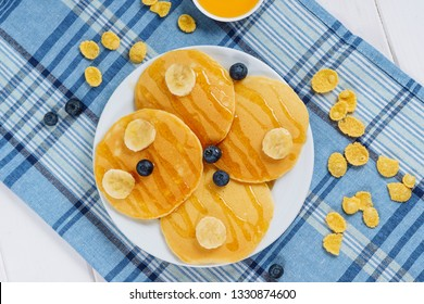 Pancake Stack Blueberry Honey Dessert Flatlay. Fried Golden Sweet Crepes for Delicious Shrovetide Light Breakfast. Tasty Hotcake Product on White Plate with Banana Top Down. Healthy Morning Food
