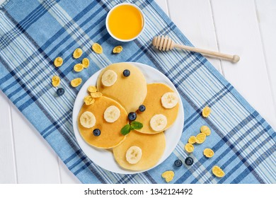 Pancake Stack Blueberry Honey Dessert Flat Lay. Fried Golden Sweet Crepes for Delicious Shrovetide Breakfast. Tasty Hotcake Product on White Plate with Berry and Banana Top Down. Homemade Morning Food