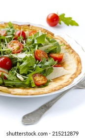 Pancake with tomato and rucola and cheese