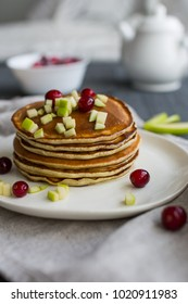 Pancakes with apple, berries and honey. Concept health breakfast.