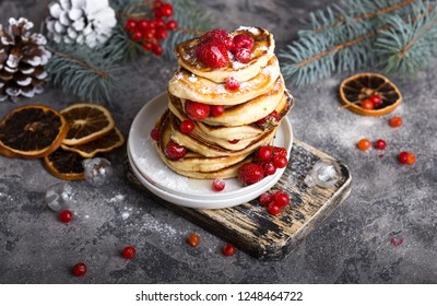 Pancakes with berry on grey  stone Background, Christmas Dessert.
