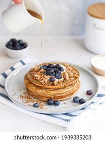Pancakes with Blueberries, Maple Syrup, Kokos Yogurt on white background