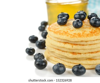 Pancakes with blueberries on a white background