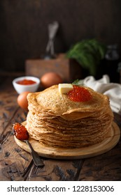 Pancakes with caviar and butter