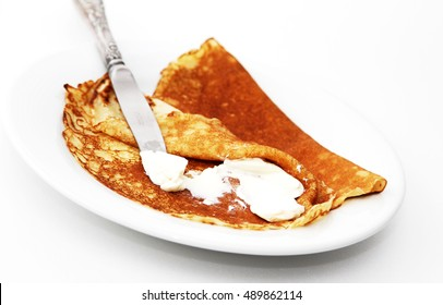 Pancakes with cheese on plate isolated on white background