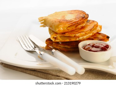 Pancakes with with cheese and strawberry jam.
