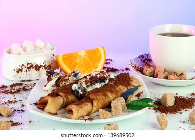 Pancakes with chocolate on light background