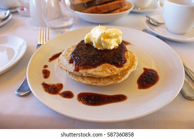 Pancakes with clotted cream on board The Ghan Expedition service in Australia