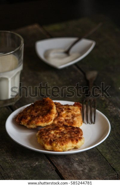 pancakes with cottage cheese and corn (cheesecakes) on the table. breakfast