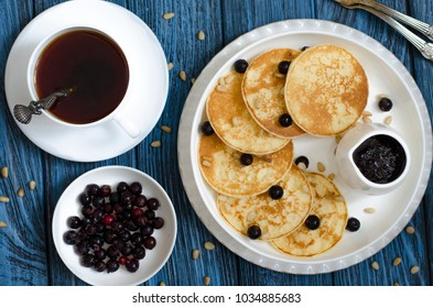 Pancakes with cream of berries for breakfast