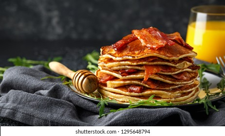 Pancakes with crispy bacon and maple syrup in a plate. Morning Breakfast