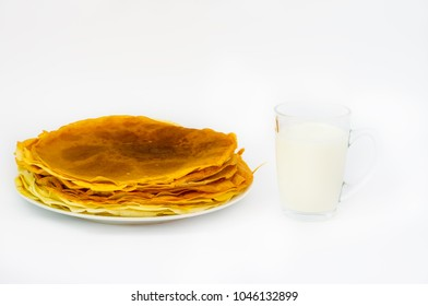 Pancakes and cup of milk