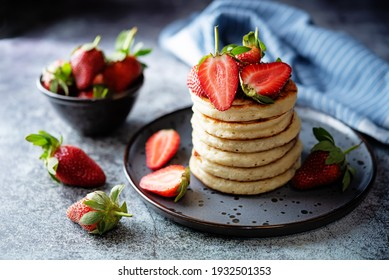 Pancakes decorated with strawberries in a plate. toning. selective focus