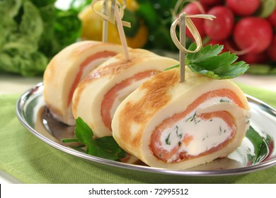Pancakes filled with smoked salmon and cream cheese