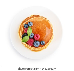 Pancakes with fresh berries and maple syrup on the  plate isolated on white background, top view