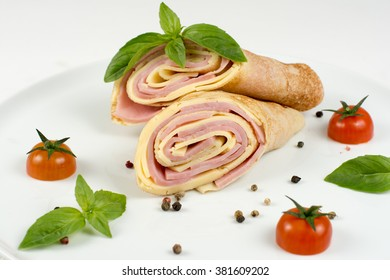 Pancakes with ham and cheese on white plate closeup isolated on white