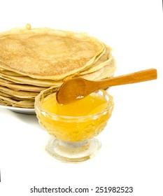 pancakes with honey on white background
