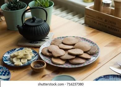 Pancakes, iron teapot in background