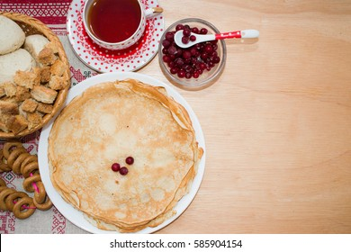 Pancakes to Maslenitsa celebration on the background of wooden boards