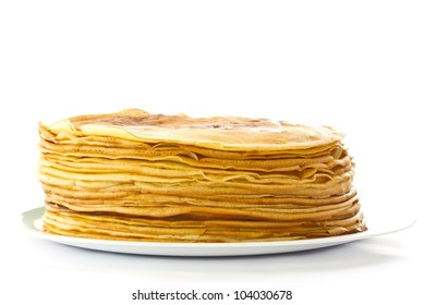 Pancakes a lot on his plate on the white background