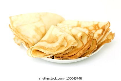 a lot of pancakes on a plate isolated on white background