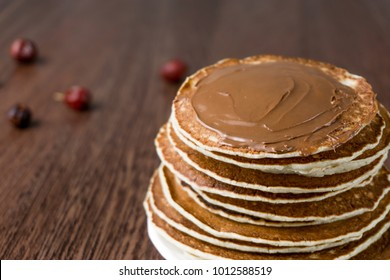 Pancakes on a table with jam