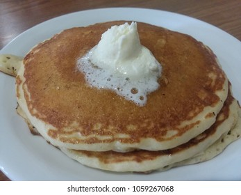 Pancakes on a white plate with butter, no syrup