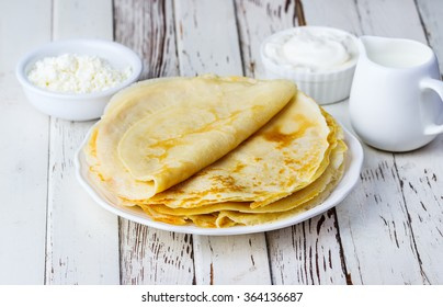pancakes on a white wooden background