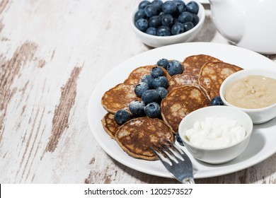 pancakes with peanut butter and yoghurt on white background, top view