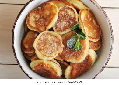 pancakes with powdered sugar on the plate - top view