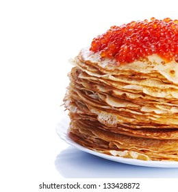 Pancakes with red caviar. Pile of pancakes. Pancakes on a plate. Red caviar.