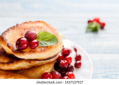 Pancakes with sour cream and berries. Summer cottage delicacies