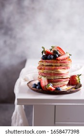 pancakes with strawberries, blueberries and honey