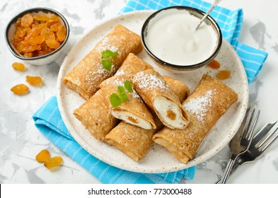 Pancakes stuffed with cottage cheese and raisins. A delicious sweet dessert