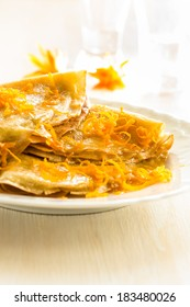 Pancakes with sweet citrus  sauce, classic French dessert crepes Suzette