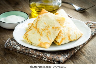 Pancakes, thin crepes stuffed with peas and bacon, to Russian Maslennitsa