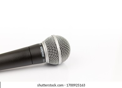 Pancevo, Serbia - 04/11/2020: Shure SM58 Microphone isolated above white background.