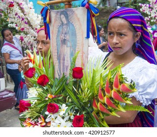 PANCHIMALCO , EL SALVADOR - MAY 08 : Salvadorian girls participate in the procession of the Flower & Palm Festival in Panchimalco, El Salvador on May 08 2016