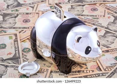Panda bank on top of American currency
